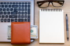 workspace with wallet, banknotes, laptop, eyeglass, notebook and royalty free stock photos