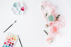 Workspace. watercolor, paintbrush, palette, tools and roses with textile. On white background. Overhead view. Flat lay, top view royalty free stock photography