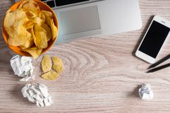 Free Workspace With Laptop,crumpled Paper And Bowl Of Chips On Wood Table. Bad Habits Concept Stock Photo - 111158370
