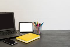 Free Workspace With Laptop, Yellow Diary, Photo Frame, Color Pensils Royalty Free Stock Photos - 105637148