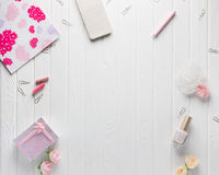 Workspace with women`s accessories on a white old wood backgroun Stock Image