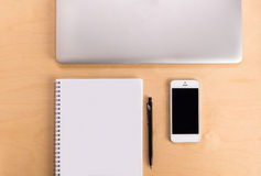 Workspace on wood table with laptop, sketchbook, pencil and telephone. Creative concept of a designer's work office desk. stock image