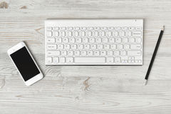 Workstation at a white rustic wooden desk Royalty Free Stock Photo