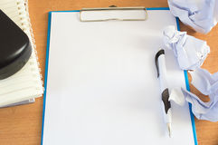 Worktable covered with blank document and pen Stock Images