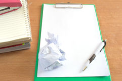Worktable covered with blank document pen and books. Background Royalty Free Stock Photos