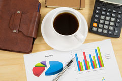 Worktable covered with business report Stock Photo