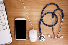 Worktable healthcare, medicine. Health desk staff stethoscope, phone and computer Royalty Free Stock Images