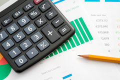 Worktable in the office. Calculator and pencil Stock Photos