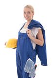 Workwear concept - happy young woman in blue builder uniform hol Stock Photo
