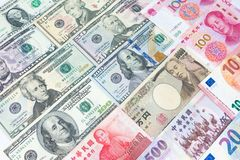 World's various currencies from several different countries. C. Loseup assorted American dollar bills and Asian currencies such as Chinese yuan, Taiwan dollar Stock Image
