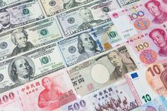 World's various currencies from several different countries. C. Loseup assorted American dollar bills and Asian currencies such as Chinese yuan, Taiwan dollar Royalty Free Stock Images