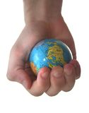 World. Holding little plastic globe ball Stock Photography