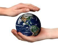World. (globe picture from NASA) in the palm of a child's hand Stock Photo