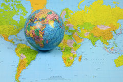 The World. Picture representing the earth by the maps, a Spherical world map (Globe) well focused and its flat representation known as map is blurred background Royalty Free Stock Photos
