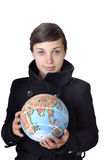 World. Pretty young woman holding the world in her hand royalty free stock images