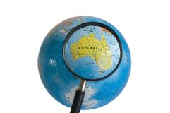 World 3D Puzzle (Australia). Looking at Australia through magnifying glasses Royalty Free Stock Photo