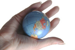 World. A miniature globe in the palm of a hand. The western hemisphere is visible Stock Image