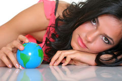 World. Beautiful girl and small globes Royalty Free Stock Photography