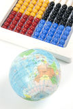 World and Abacus. A ball textured with world map and a simple wkite abacus on white background Royalty Free Stock Images