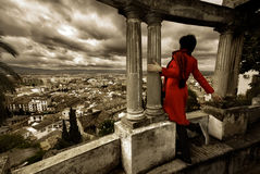 The World ahead. A woman looking at a viewpoint of the city of Granada, with a posture that resembles the freedom to do around the world ahead Royalty Free Stock Photography
