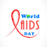 World Aids Day concept with red aids awareness ribbon. Royalty Free Stock Photo