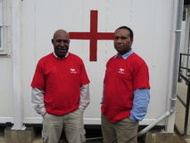World Aids day in PNG. The red shirts were worn during the world Aids day in Papua New Guinea. In this a two health workers Stock Photos