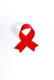 World aids day.Red Aids ribbon.World AIDS Day 1 December. Red AIDS ribbon isolated on white background with shadow. AIDS icon Royalty Free Stock Image