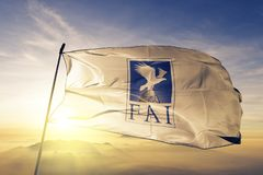 The World Air Sports Federation Aeronautique Internationale FA flag textile cloth fabric waving on the top sunrise mist fog. Beautiful royalty free illustration