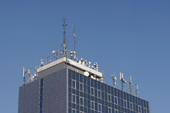 World antennas. On the roof of the building royalty free stock photo