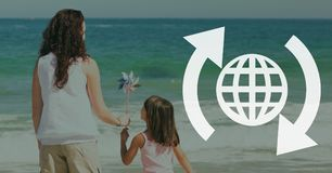 World with arrows icon against beach background Stock Image