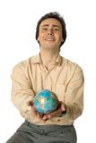 World as a gift. An isolated photo of a smiling man with a globe Royalty Free Stock Images