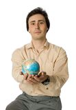 World as a gift. An isolated photo of a man with a globe Royalty Free Stock Image