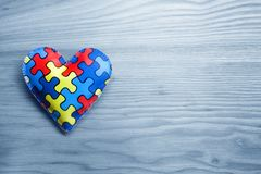 World Autism Awareness day, mental health care concept with puzzle or jigsaw pattern on heart. Top view stock images