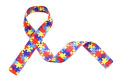 World Autism awareness and pride day with Puzzle pattern ribbon isolated on white. Background Royalty Free Stock Photo