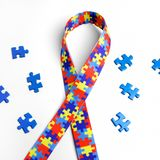 World Autism awareness and pride day with Puzzle pattern ribbon on white background with clipping path. World Autism awareness and pride day with Puzzle pattern Royalty Free Stock Photos