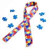 World Autism awareness and pride day with Puzzle pattern ribbon on white background with clipping path. World Autism awareness and pride day with Puzzle pattern Royalty Free Stock Images