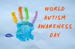 World autism awarenss day. Child`s handprint on white background as a symbol of autism awareness day Royalty Free Stock Images