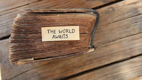 The World Awaits idea. The World Awaits text and  old book stock footage