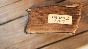 The World Awaits idea. The World Awaits text and  old book stock video