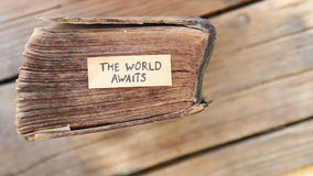 The World Awaits idea. The World Awaits text and  old book stock video footage