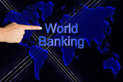 World Banking and Finger. Finger pointing on world map background with banking and Royalty Free Stock Photos