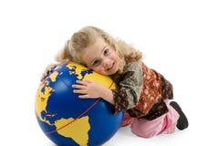 The world belongs into children hands stock photography