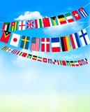 World bunting flags on blue sky. Stock Image