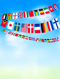 World bunting flags on blue sky. Royalty Free Stock Image