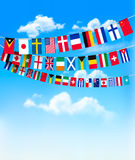 World bunting flags on blue sky. Royalty Free Stock Photo