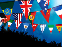 World bunting flags with crowd over blue background Stock Images