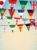 World bunting flags2. World flag bunting on a blue background background Stock Photo