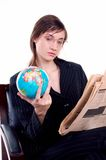 World business. Young business woman looking where to invest Stock Image