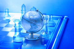 World Global Business Strategy Chess Trade. An image combining chess and a world globe trying to convey global business strategy Stock Photos