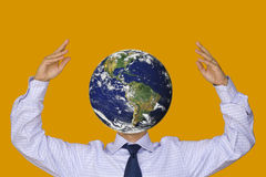 The World of Bussiness. A businessman with a world face between his hands Stock Photo